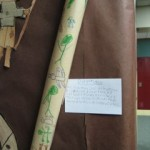 a didgeridoo made of paper and decorated